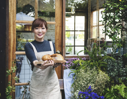 Young asian lady entrepreneur bakery garden